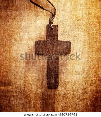 Closeup of wooden Christian cross on grunge background - stock photo