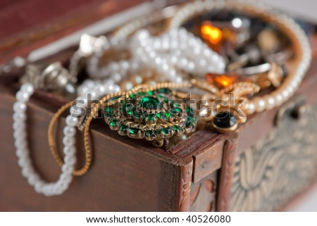 Closeup of Wooden Treasure chest with valuables - stock photo