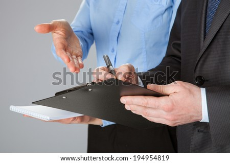 Closeup of working business team discussing documents, concept of successful team work - stock photo