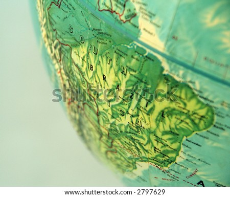 closeup of World globe focused on Brazil with blue background - stock photo
