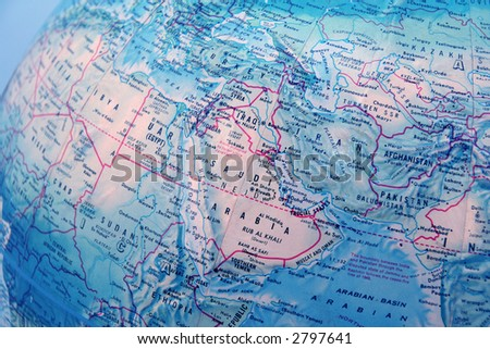 closeup of World globe focused on middle east with blue background - stock photo