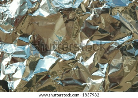 Closeup of wrinkled aluminum foil - stock photo