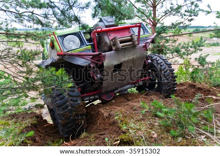 Closeup of 4x4 truck driving uphill with winch - stock photo