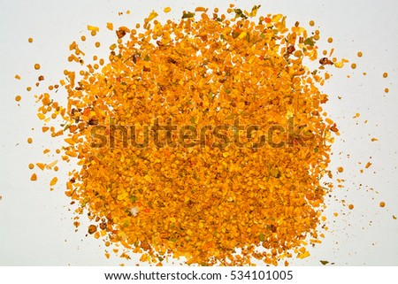 closeup of yellow spices mixture of garlic, turmeric, mustard greens