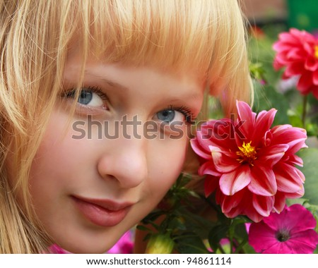 Closeup of young attractive girl with a flowers - stock photo