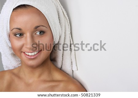 Closeup of young attractive spa woman with beautiful smile