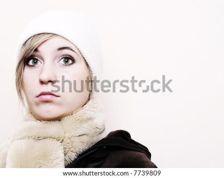 Closeup of young beautiful girl, wearing wool winter hat - stock photo