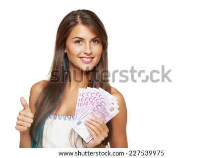 Closeup of young beautiful woman with euro money in hand gesturing thumb up sign, over white background - stock photo