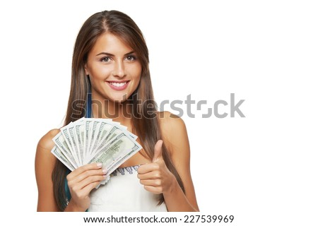 Closeup of young beautiful woman with us dollar money in hand gesturing thumb up, over white background, with copy space - stock photo