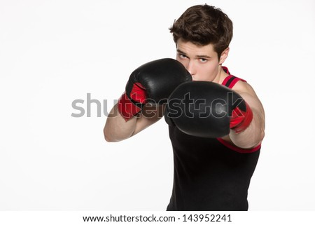 Closeup of young boxer fighter over white background
