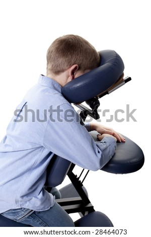 closeup of young boy sitting in a chair massage - stock photo