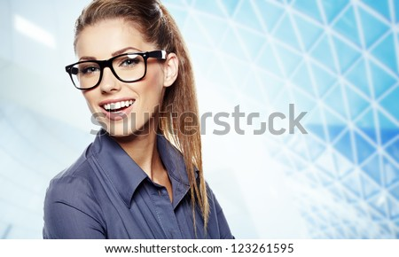 Closeup of young business woman giving you attractive smile - stock photo
