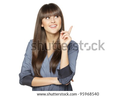 Closeup of young business woman pointing at copy space, isolated on white background