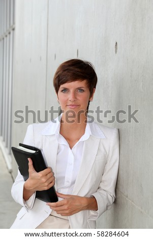 Closeup of young businesswoman - stock photo