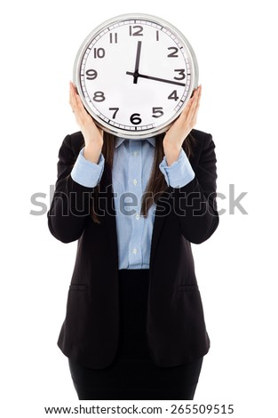 Closeup of young businesswoman covering her face with analog clock isolated on white background, time pressure concept