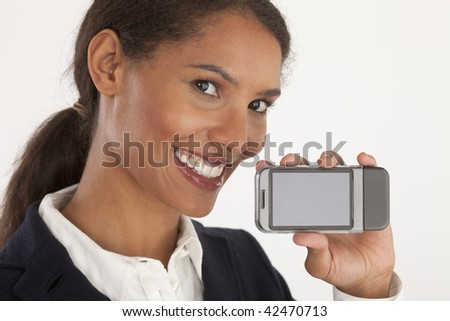 Closeup of young businesswoman holding mobile device. Horizontally framed shot.