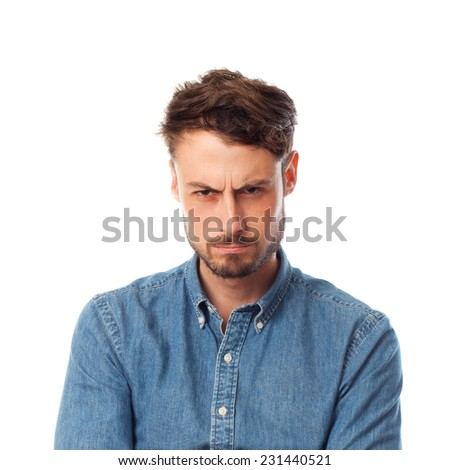 closeup of young cool man with disgusted gesture - stock photo