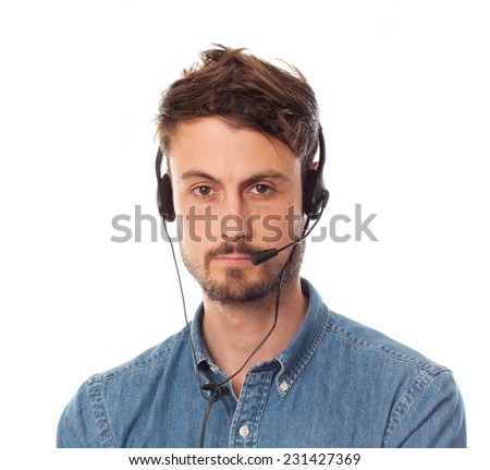 closeup of young cool telemarketer man - stock photo