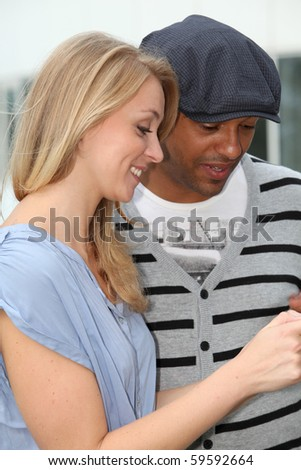 Closeup of young couple with telephone