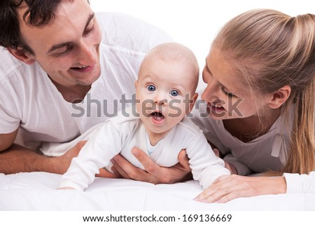 Closeup of young family with baby boy against white background  - stock photo