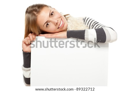 Closeup of young female holding blank copy space sign, over white background - stock photo