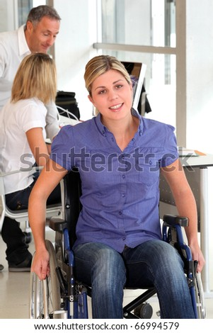 Closeup of young handicapped worker in the office - stock photo