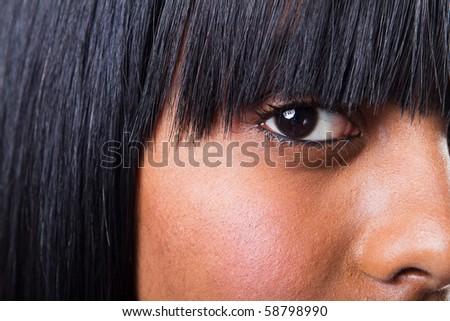 closeup of young indian woman's eye - stock photo