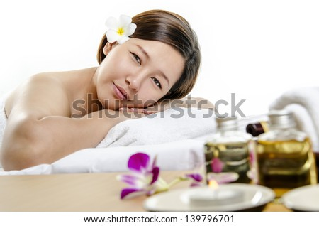 Closeup of young lady at spa and massage against white background - stock photo
