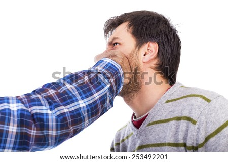Closeup of young man being punched in the face over white background - stock photo