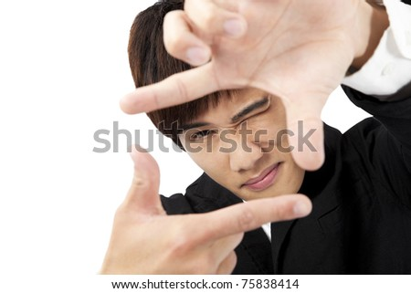 Closeup of young man making frame with  hands - stock photo