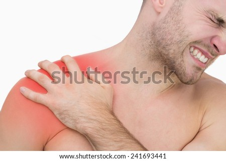 Closeup of young shirtless man with shoulder pain over white background - stock photo