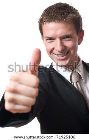 closeup of young smiling businessman with thumb up isolated on white background - stock photo