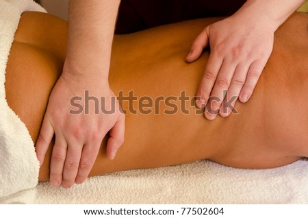 closeup of young woman getting a back massage
