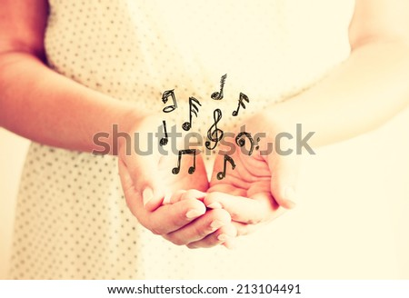 closeup of young woman hands, outstretched in cupped shape. selective focus. retro toned image.  - stock photo
