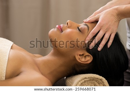 Closeup of young woman receiving professional head massage at spa  - stock photo
