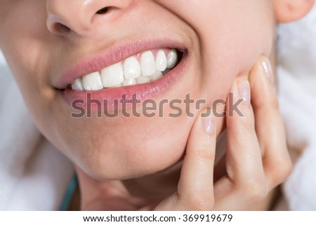 Closeup of young woman suffering from toothache at home - stock photo