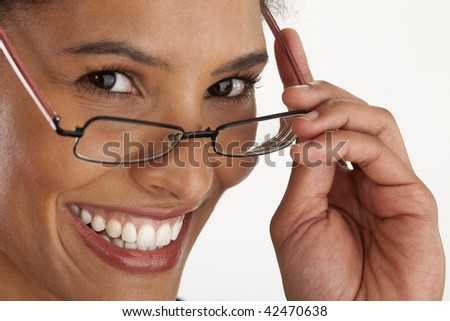 Closeup of young woman wearing glasses. Horizontally framed shot.