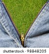 Closeup of zipper with grass field in blue denim. - stock vector