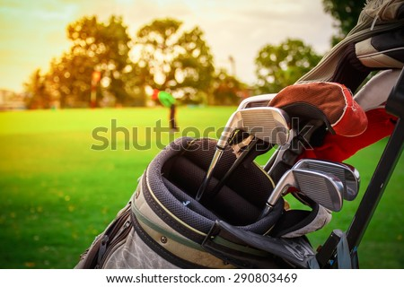 closeup old golf bags on green - stock photo