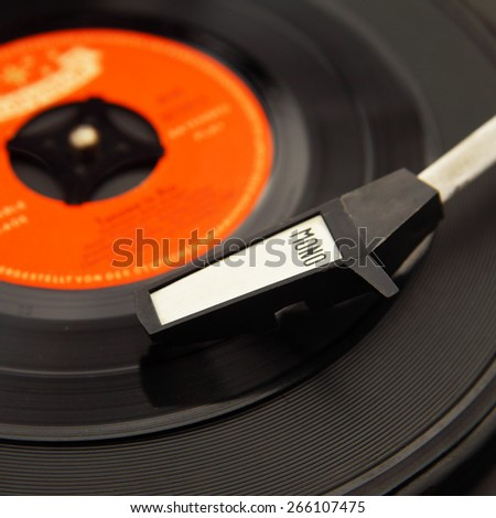 Closeup old record player with phonorecord - stock photo