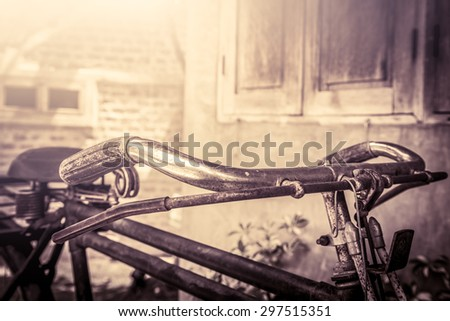 Closeup old rusty bicycle handle bar in vintage color tone - stock photo