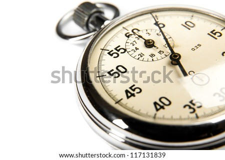 Closeup old stopwatch on white background - stock photo