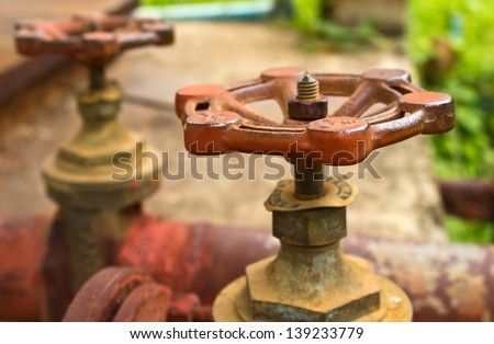 Closeup old water pipes and valves - stock photo