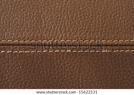 Closeup on a leather texture with a linear stitch
