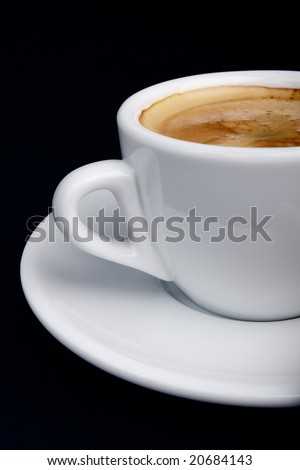 Closeup on a white cup of coffee (espresso). - stock photo