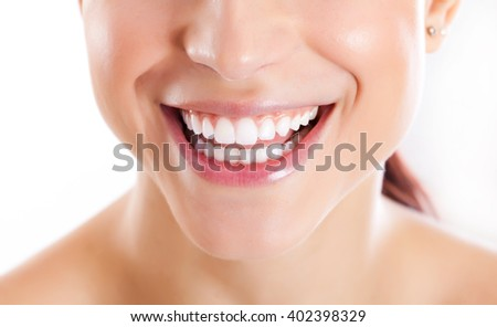 Closeup on a white toothy smile of a young woman - stock photo