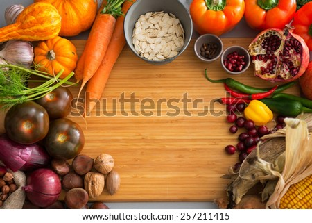 Closeup on autumn vegetables on cutting board - stock photo