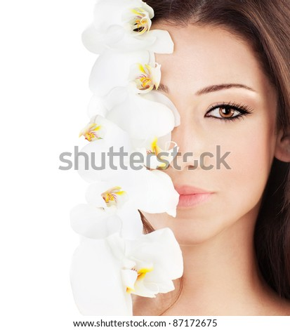 Closeup on beautiful face with white orchid flower, perfect clean skin, young female portrait,  isolated on white background with text space, beauty and spa concept - stock photo