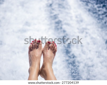 Closeup on beautiful sexy women's feet on the yacht, carefree vacation, journey on sailboat, happy and healthy lifestyle, pleasure concept - stock photo