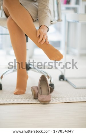 Closeup On Business Woman In Office With Foot Pain Stock